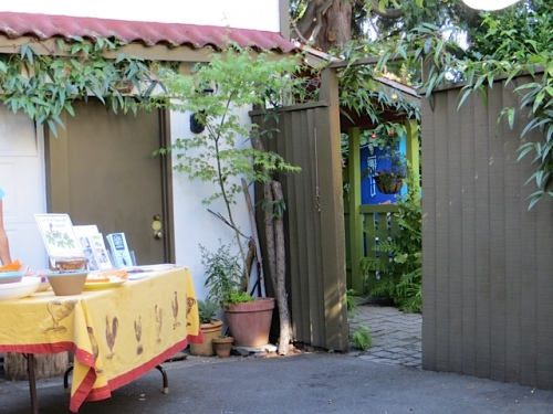 at the end of the driveway, by the garage, refreshments and literature about bird-friendly gardens.