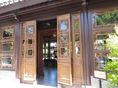 Beside the garden walkways: intricate gates into other rooms.