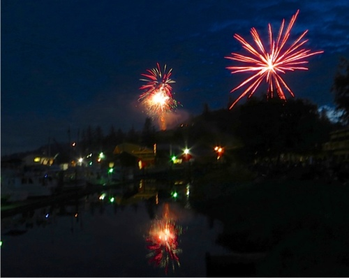 First, a big private display of fireworks goes off on the hills west of town.