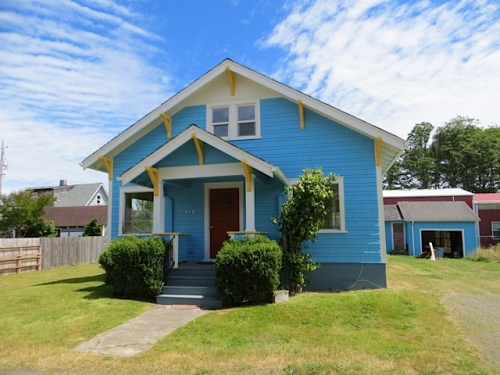 Just around the corner on Pearl Street, a blue house with matching blue sky.
