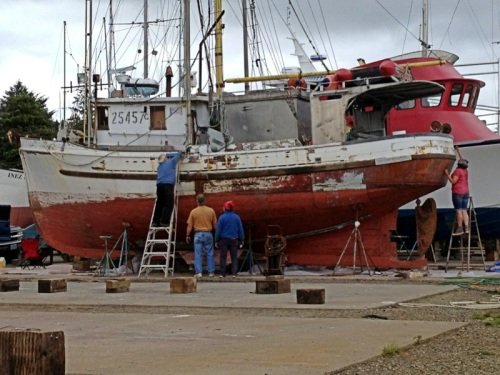 folks engaged in boat work