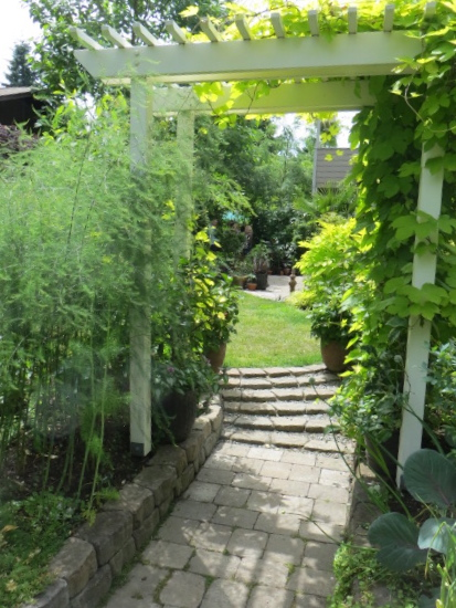 Another arbour leads to a lawn.