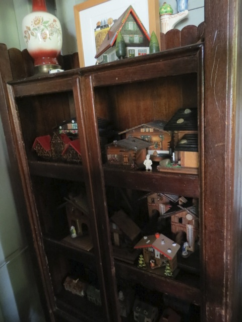 in the corner, a cabinet of little houses