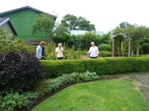 tour guests in the kitchen garden