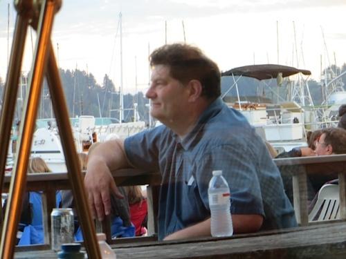 Artist Don Nisbett relaxing on the deck.