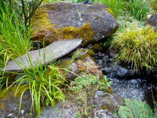 and the stream under stones