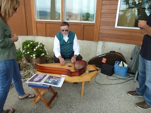 Wilho Saari playing the kantele.