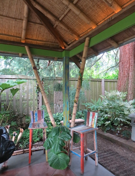 from inside the pavilion, looking to the shade garden corner