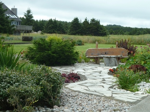 Changes in texture of paving make an interesting walk through the garden.