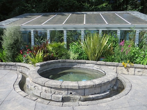 It starts with this round pool by the large greenhouse (full of exotics, but in 90 plus degree weather, I did not go in).