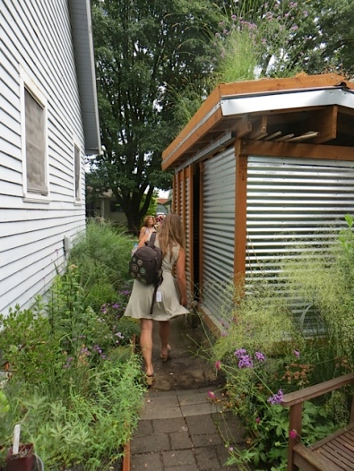 tall and narrow with a green roof