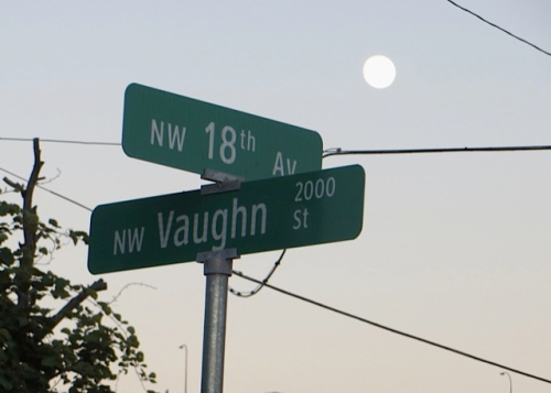 street signs with full moon