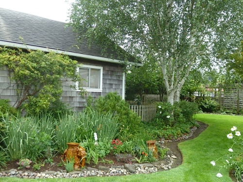 The south side of the rental cottage makes one side of Patti's front garden.