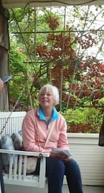 Patti's friend on the porch swing