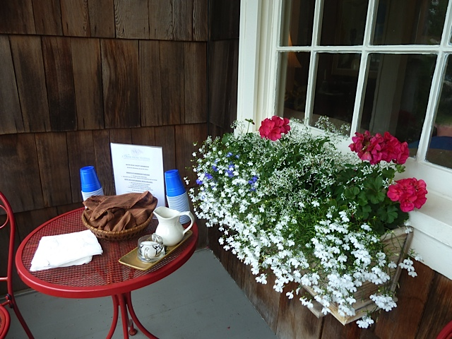at one end of the porch, treats