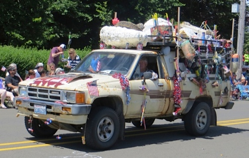 Their truck is decorated with debris found on the beach.