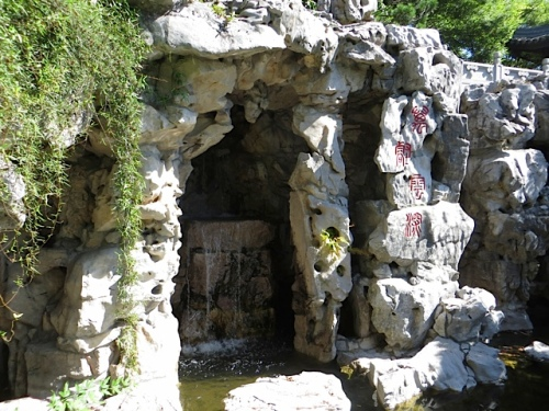 at the back of the garden, a waterfall in a grotto.