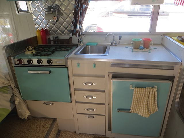 lots of blue appliances in these old trailers