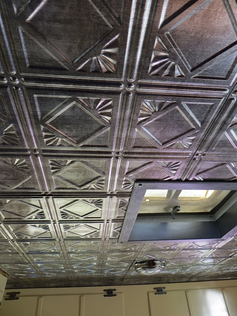 love the tin ceiling