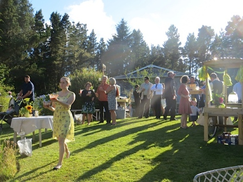 The guests spread throughout the garden at tables big and small.