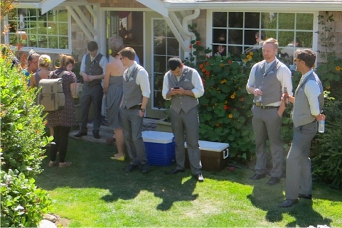 the groomsmen gathered behind the house