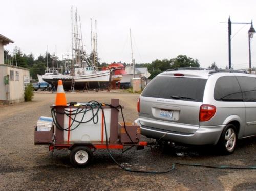 the water trailer, where he fills it in the Ilwaco boatyard