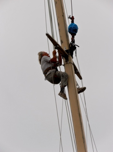 He fastened the crane's hook to the mast and lowered himself down.