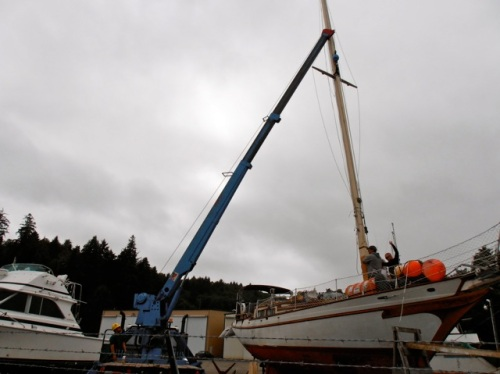 the mast being removed by the crane