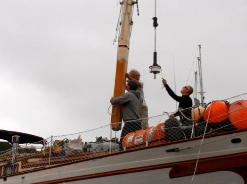 The orange at the base of the mast was below deck and indicates the lift required to raise the mast.
