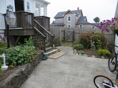 A friend of Erin's has mulched and tidied the patio behind the house and the old chain link fence was removed.
