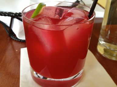 a cocktail with Starvation Alley organic cranberry juice