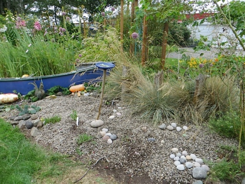 There is horsetail in there...the little scrimmy kind...hope it won't be too hard to pull through the gravel.