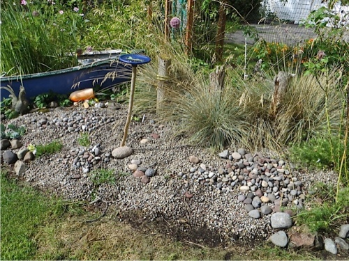 more river rock added to scree bed, to be arranged later