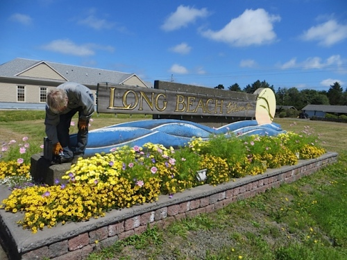 the weekly deadheading of the welcome sign, front...