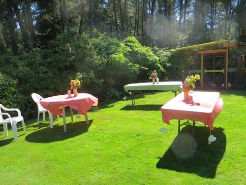 tables set up beside the house