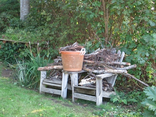 two chairs plus an oyster basket of bark and kindling