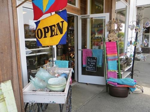 Cute shops like The Wooden Horse provide eye candy along the sidewalk.