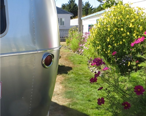 an Airstream by the garden shed