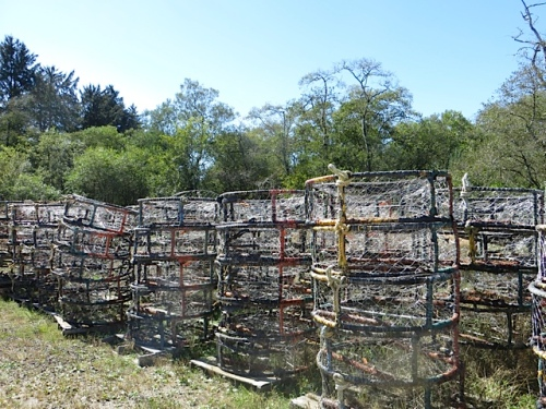 crab pots stacked near the barn awaiting the winter season
