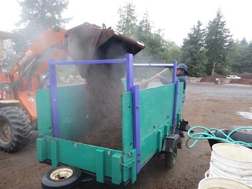 debris unloaded, getting a yard of steaming mulch