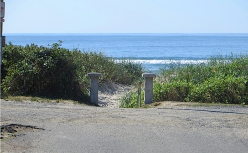 at the end of the block (one lot away), the path right to the beach