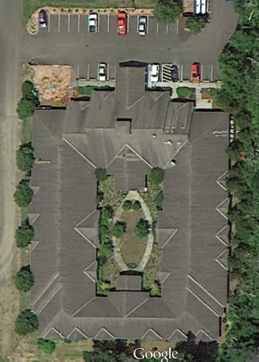 Google Earth of the building surrounding the courtyard.