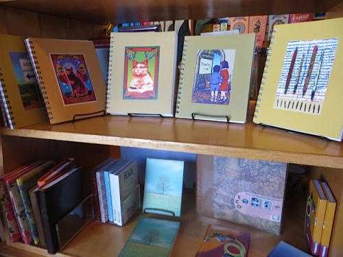 It has three shelves of blank journals, of course.