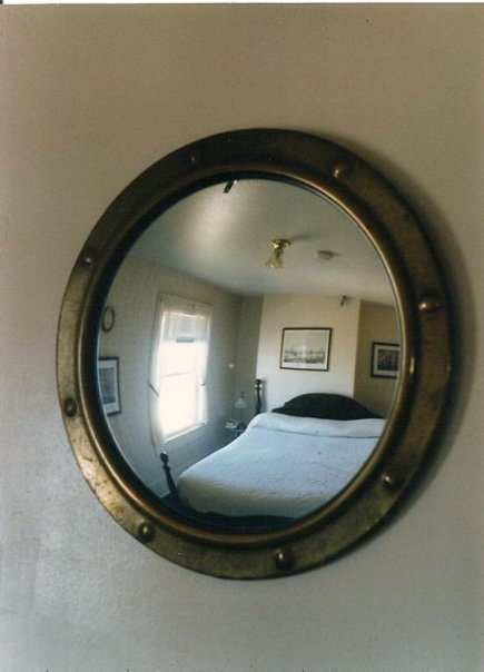 the mirror itself, in 1991, with the Great White Bed.