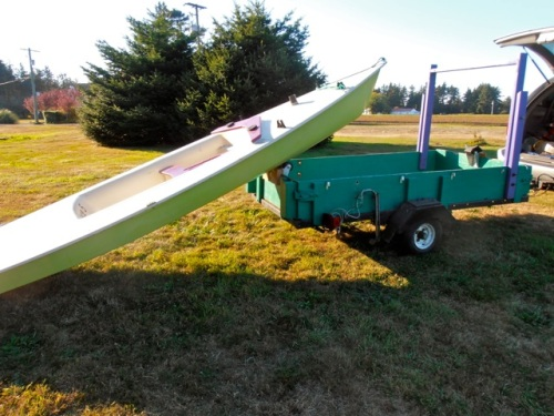 I loaded up the boat, strimmed the grass where it had been, and loaded it on the vertical cart .