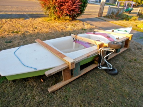 home for repairs; the purpose of the vertical cart is to move the boat through narrow garden paths.