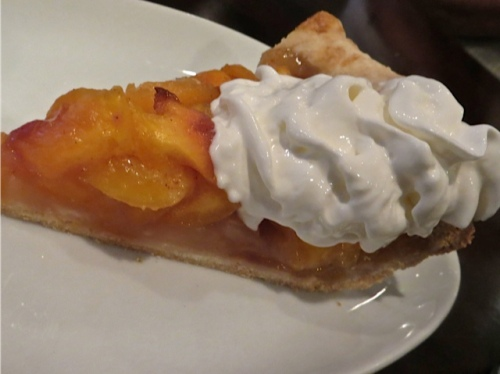 A slice of peach pie was Allan's reason for just getting one fish taco and a salad.