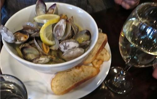 John braised the lemony broth bathing the steamer clams.