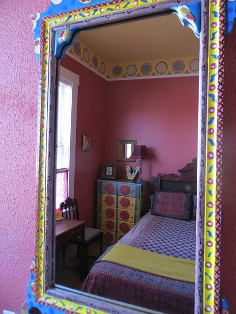 Virginia's sister, Vanessa Bell, painted walls and furniture in this style, inspiring the decoration of this room.