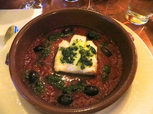 Baked Pacific cod with kalamata olives, tomatoes, onions, and salsa verde